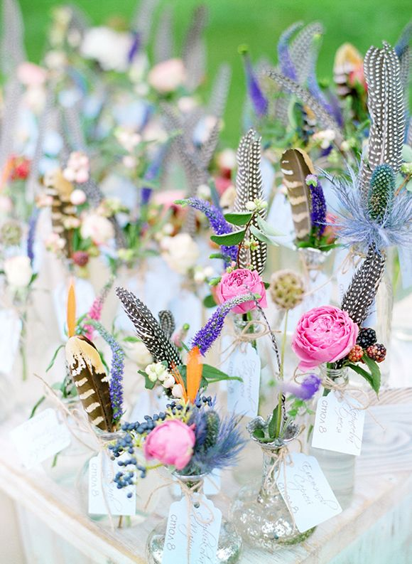 Boho feathers and flowers in vases with name cards