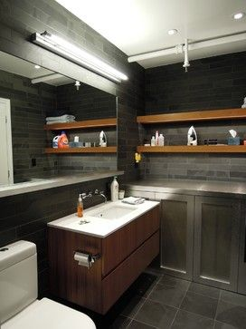 This contemporary NYC bathroom has a lot of cool touches, including exposed fire sprinkler piping. via Houzz www.HomeFireSprinklers.org