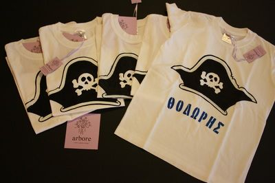 Hand stenciled boy's t shirt, featuring a pirate's hat. These t-shirts were birthday party favors, so every tee has its recipient's name on it. The colors are non-toxic, water based, permanent fabric colors. This design can be fully personalized and custom made.