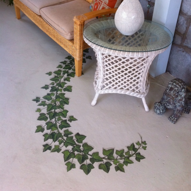 Hand-painted ivy vine on our sun room floor hides the crack in the concrete.
