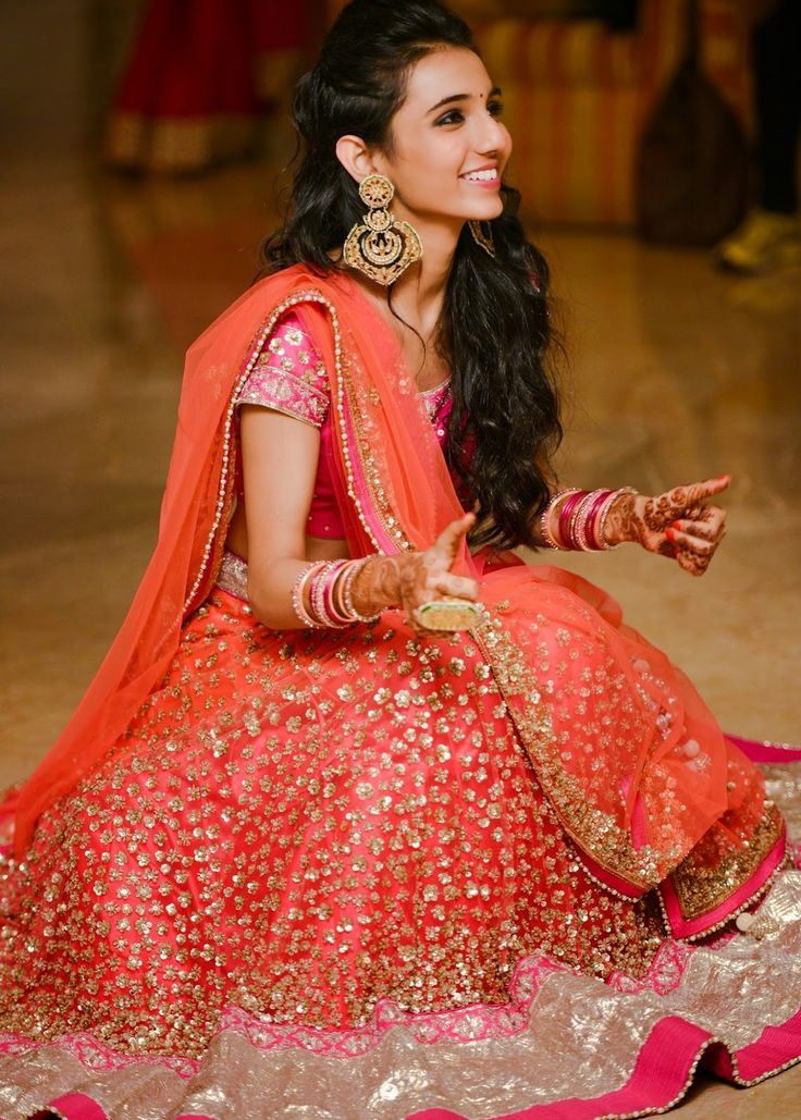 Indian bride wearing bridal lehenga and jewelry. #IndianBridalHairstyle #IndianBridalMakeup #IndianBridalFashion #BridalPhotoShoot