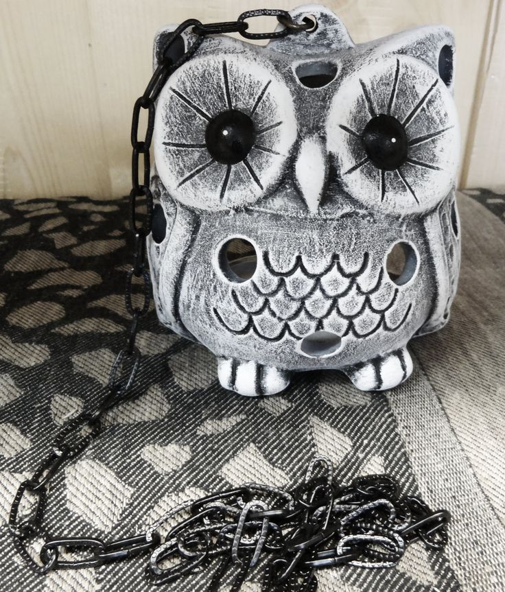 Ceramic owl, color is grey. Owl is suitable for inside and outside uses.
