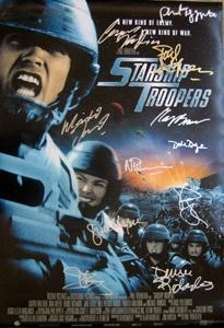 Starship Troopers original movie poster cast signed by Casper Van Dien, Dina Meyer, Denise Richards, Jake Busey, Neil Patrick Harris, Clancy Brown, Michael Ironside, Dale Dye, Phil Tippett, David Bowie & director Paul Verhoeven.