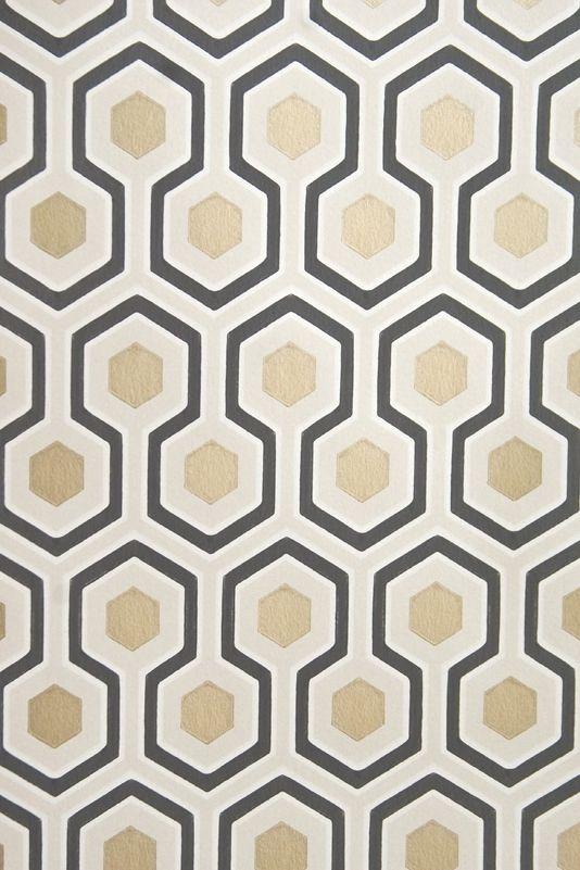 Hicks' Hexagon Wallpaper Small Geometric Design design wallpaper in Cream and Black with metallic gilver embellishment.