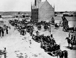 Cheyenne and Arapaho chiefs arrive in Denver with their white captives on September 28, 1864.: