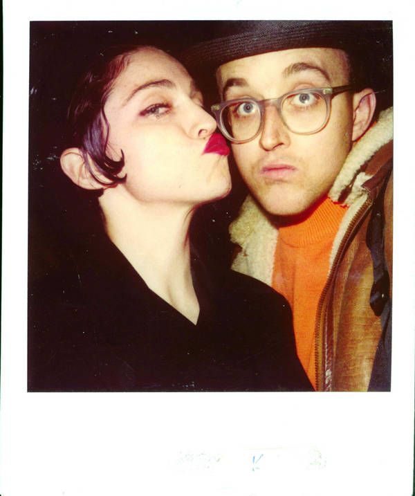 Keith Haring with some chick he used to let crash on his couch named Madonna