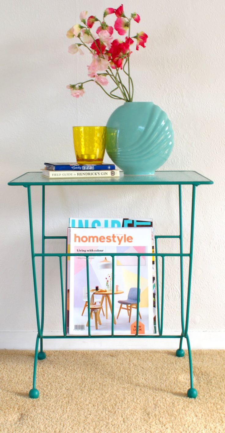 Cool little magazine rack that functions as a side table as well