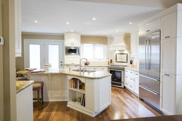 Love the granite countertop wood floors and white cabinets.  Seems to be missing some drama.  lighting?