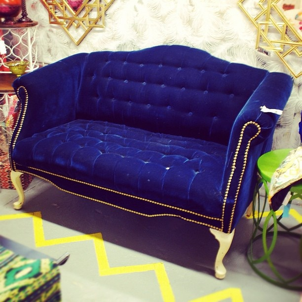 Blue velvet tufted sofa $345
