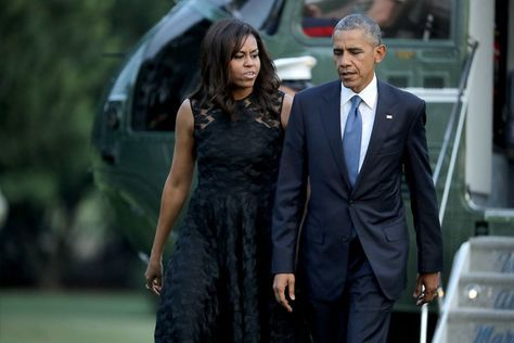 Michelle Obama Photos - (AFP OUT) U.S. President Barack Obama (R) and first lady Michelle Obama walk across the South Lawn after returning to the White House on Marine One July 12, 2016 in Washington, DC. The Obamas were returning from Dallas where they attended a public memorial service for the five Dallas police officers who were killed by a sniper last week during a Black Lives Matter demonstration. - President and Mrs. Obama Return to the White House