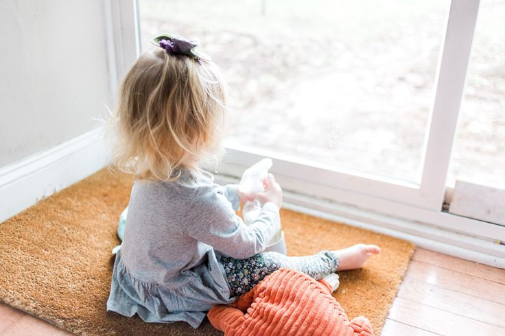 Why we give our toddler chores and the chores she's capable of doing around the house.
