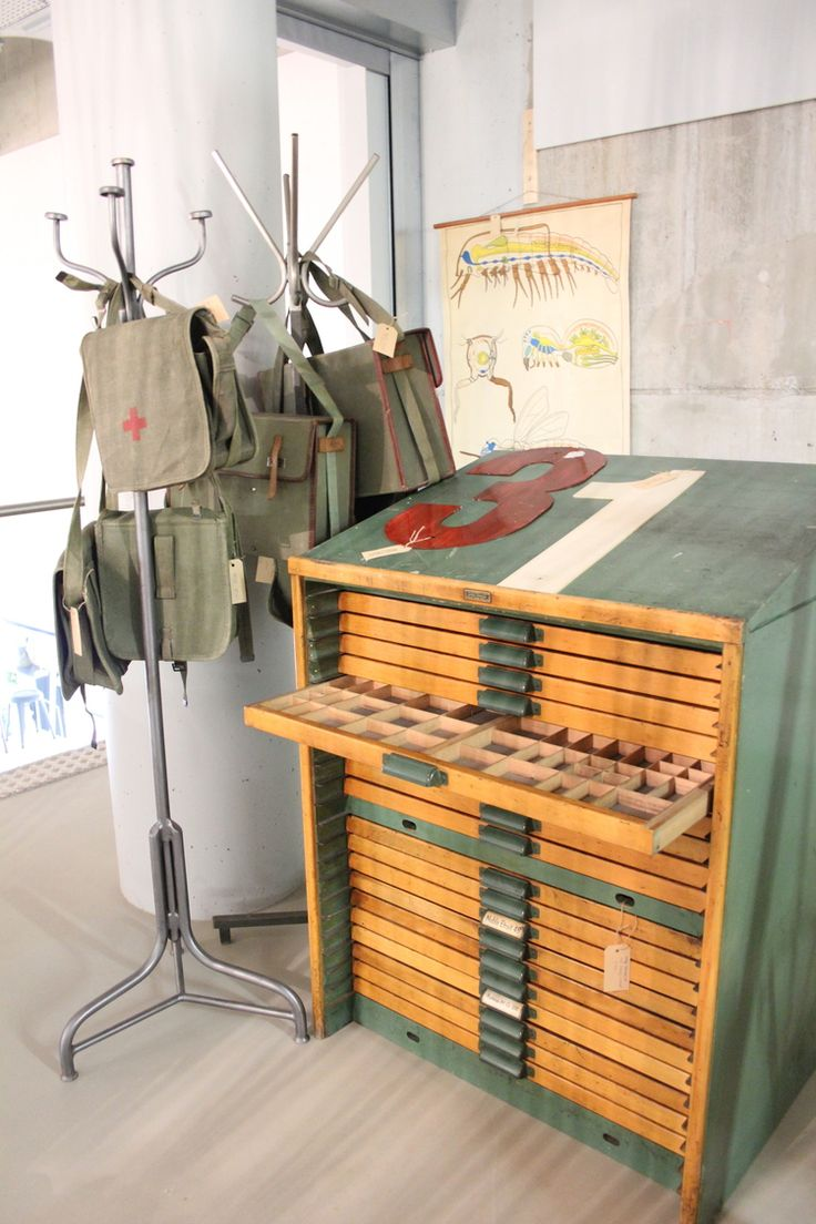 Great picture made by Jose from @Enjoy! The good life @Homestock, Haarlem. Our Best of the Past - Industrial Vintage letterpress cabinet from Bruxelles,two metal coat stands, medical green canvas bags from the 1960s and an antique anatomical scientific illustration on the wall.