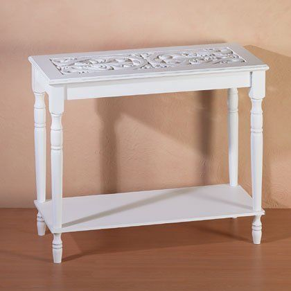 "White Wood Carved Table [Kitchen] by sml. $69.99. A must-have for the romantic heart. Turned legs and an intricately carved top add rich visual appeal to this enchanting white wood table.  Specification  Assembly required. (Items on table for display purposes.) 35"" x 14"" x 29"" high."