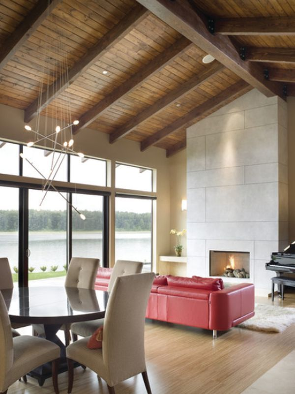 Contemporary living room with a pitched wooden ceiling and exposed beams                                                                                                                                                                                 More