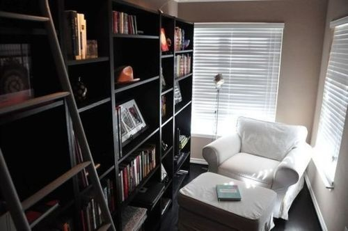 Love this space. It's a little dark. I might choose white shelving and a darker, print chair, but think that the use of space is great for a tiny room or hallway. I could see myself there A LOT!