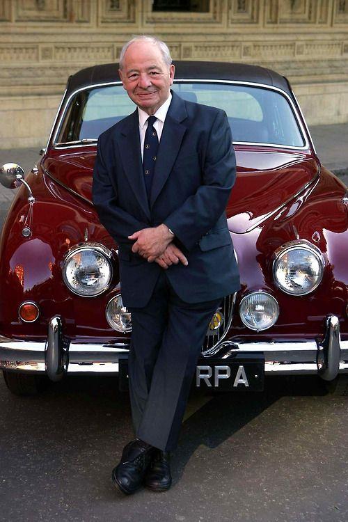 Colin Dexter leans on Morse's car.