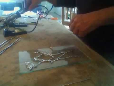Decorative soldering How To - YouTube. Very different (for the little I know) almost creating a freehand  picture with soft solder over glass (could use tempered glass??) then secure to another surface.  Lots of potential. Spellhunter Glass