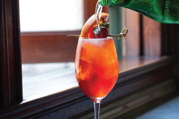 Rivington Punch     2 oz dry rosé wine  1/2 oz St-Germain  1 1/2 oz Aperol  1/4 oz raspberry liquor, preferably Combier Framboise  1 oz soda water    Stir ingredients over ice in a wine glass. Garnish with strawberry slices and grapefruit crescent