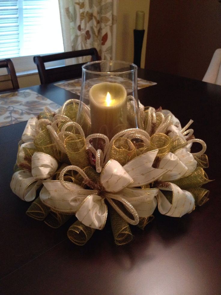 Deco mesh center piece, gold deco mesh with white and gold ribbons and tubing…