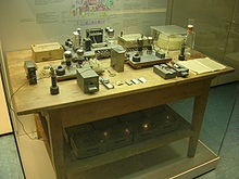 1938-1939: The experimental apparatus with which Otto Hahn and Fritz Strassmann discovered nuclear fission. On December 22, 1938, Hahn and Strassmann send a manuscript to Naturwissenschaften reporting that they have discovered the element barium after bombarding uranium with neutrons. Simultaneously, they communicate these results to Lise Meitner in Sweden. She and Otto Frisch interpret the results as evidence of nuclear fission. Frisch confirms this experimentally on January 13, 1939.