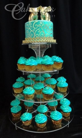 Gold and teal cupcake tower  www.cakeaters.com