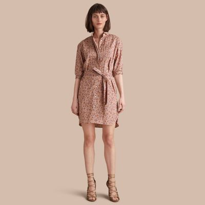 A floral print cotton shirt dress featuring a wing collar, pintuck detailing and a belt to cinch the waist. Unbutton the top buttons for off-duty dressing.