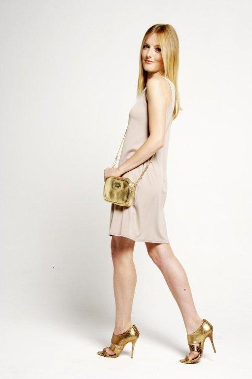 Ultra feminine and chic - add a touch of glamour to a simple beige dress with our gold evening handbag.