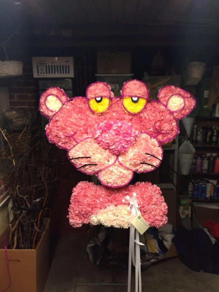 Pink Panther Flower Sculpture/ funeral flowers we recently made using carnations and creative coils. www.TheLoftFlorist.com