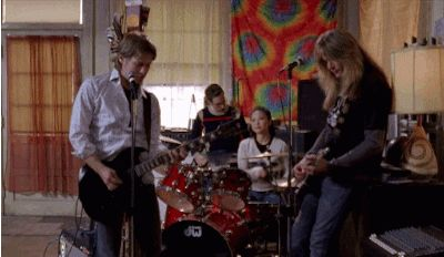 """The real Dave Rygalski, husband to Hep Alien namesake Helen Pai, would sometimes play backup guitar for Brian (John Cabrera) and Gil (Sebastian Bach) off screen. 