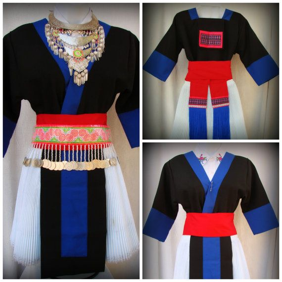 A beautiful original Hmong outfit in blue and black with white dress and red slash.