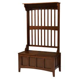 "Stow outdoor accessories and keep your foyer organized with this timeless walnut-finished wood hall tree, featuring a lift-top storage compartment and slat-back detail.     Product: Hall treeConstruction Material: WoodColor: Rich walnutFeatures:  Four coat hooksFlip-top seat Dimensions: 64"" H x 36"" W x 18"" D"