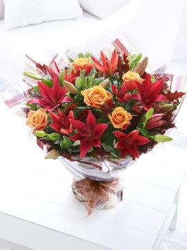 Standing bouquet wrapped in printed cellophane.