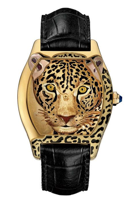 Hi-Def Leopard  Yellow gold watch with hand-engraved enamel, blue sapphire, and sapphire crystal, Cartier, price on request, call 800-CARTIER   - ELLE.com