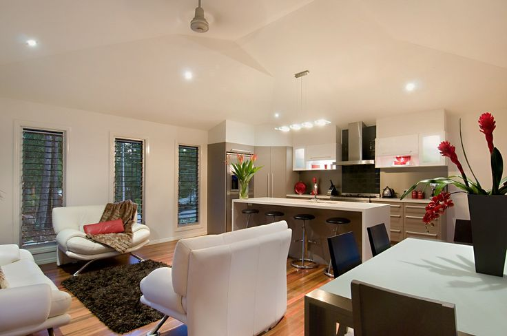 Beautiful open plan living area with timber floors throughout + big open louvre windows   Tru-Built Builders Queensland
