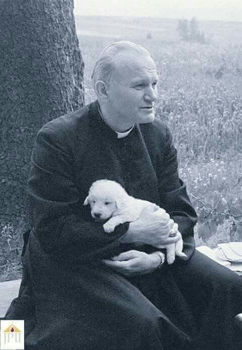 """fatherangel: """" onlytruthbeautyandgoodness: """" Having a bad day? Here's JP II holding a puppy. """" These things are why Tumblr can be cool. """""""