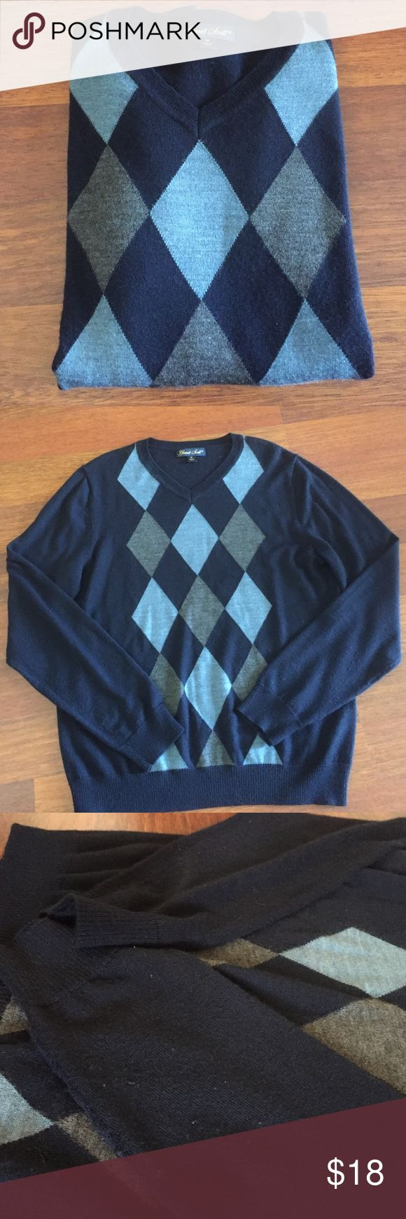 Garret Scott mens argyle sweater Garret Scott mens argyle sweater. merino wool and acrylic blend sweater. Navy with charcoal and blue argyle. Some pilling on sleeves otherwise great condition. Garret Scott Sweaters V-Neck