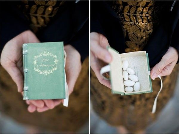For this literary-themed wedding, a clever faux book box was used to tuck away a handful of Jordan almonds–a creative way to gift a classic wedding favor candy! | See more sweet candy #wedding favors here: www.mywedding.com...