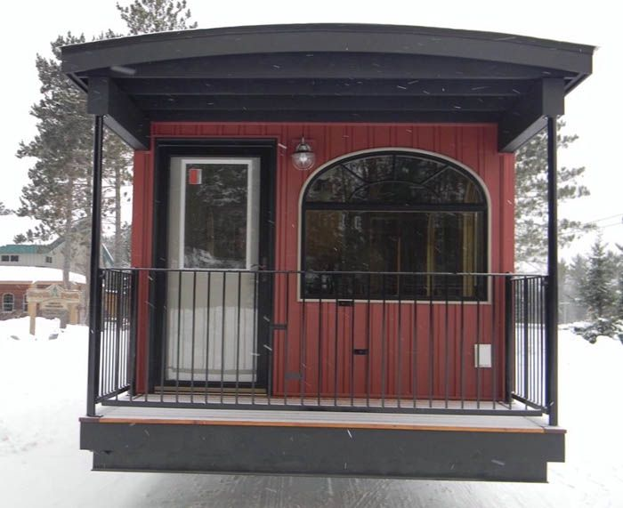 This Bespoke Park Model RV Home Built From A Train Caboose Is Real Tiny