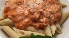 This Italian vodka sauce is simmered with just the right amount of seasoning and served over penne pasta for a filling and flavorful meal.