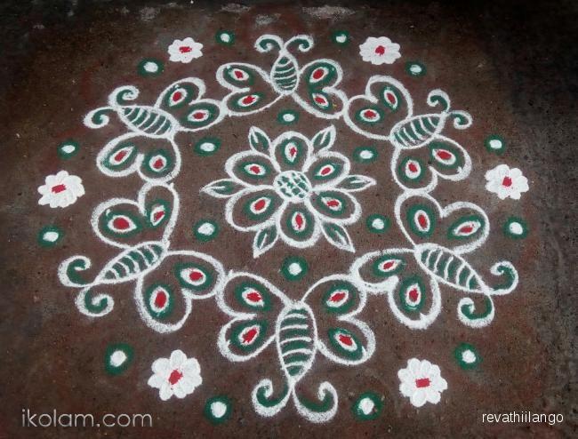 Rangoli Rev's butterfly daily kolam. 7 to 4 intermediate dots. | m.iKolam.com