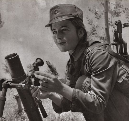 All power to the Soviets! Female soldier of the Albanian People`s Army operating a mortar.