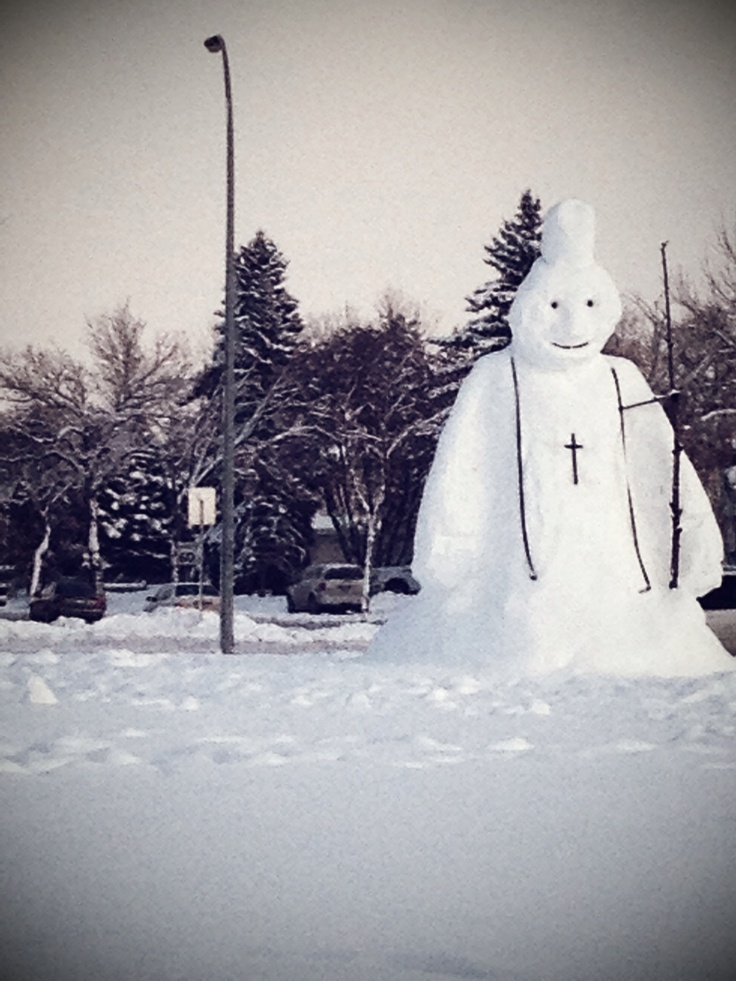 A Snow Pope in the middle of a traffic circle in Edmonton Alberta - this is winter in Canada people!