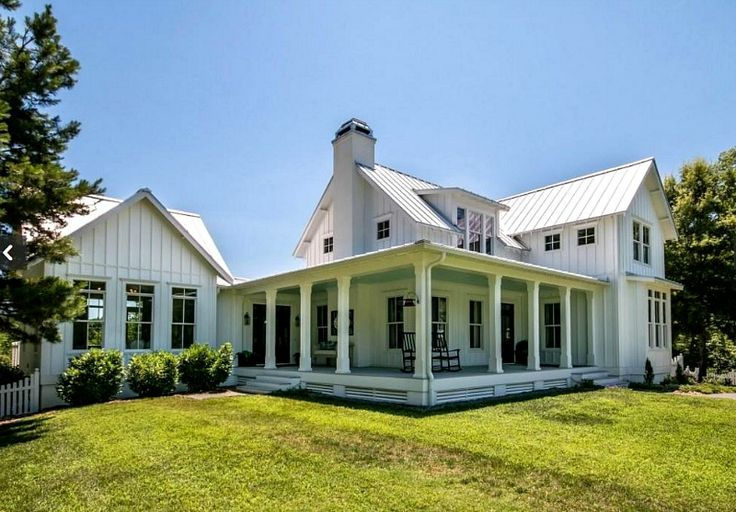 Love the wraparound porch on this Modern Farmhouse For Sale in North Carolina - Hooked on Houses