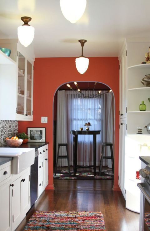 """This design trick is the epitome of easy — no heavy-lifting, no new fixtures, just paint (on a single wall!). And yet the result is far greater than the effort you'll make to get it done. """"A bold wall color paired with white cabinetry can instantly breathe in some new life into a kitchen,"""" says Karen Vidal of Design Vidal."""