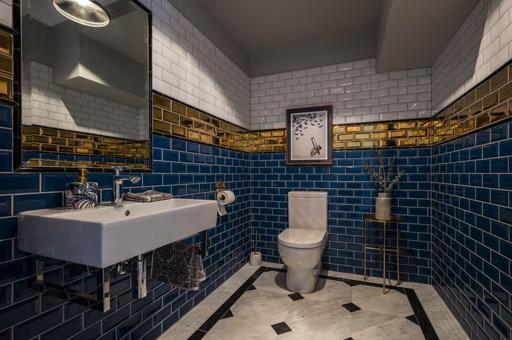 Contemporary bathroom using blue, white and gold subway wall tiles. All tiles supplied by TileStyle for this private residence in Dublin. Interior Design by Tonya Douglas of Little Design House.