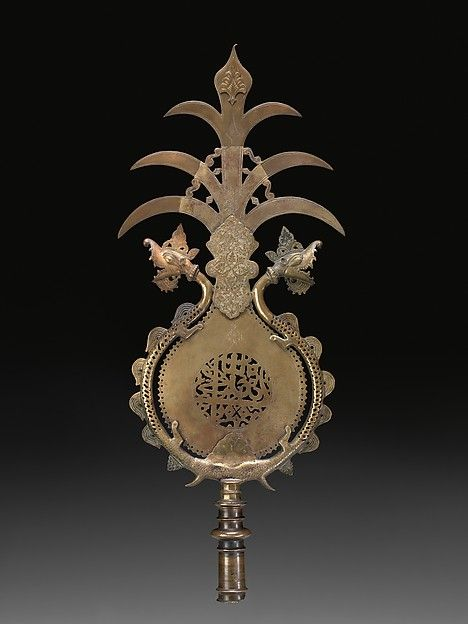 'Alam Object Name: Standard Date: ca. 1700 Geography: India, probably Hyderabad Culture: Islamic Medium: Copper alloy Dimensions: H. 28 1/2 in. (72.4 cm) W. 11 3/4 (29.8 cm) D. 1 3/4 in. (4.4 cm) Classification: Metal Credit Line: Virginia Museum of Fine Arts, Richmond, Arthur and Margaret Glasgow Fund