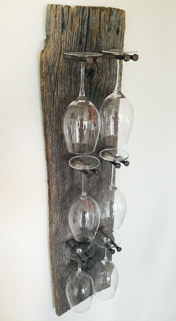 Stunning reclaimed wood wine glass rack with remarkable detail and an industrial edge. Takes any dining room or wine bar up a notch. Priced