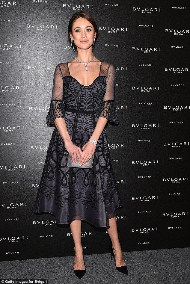 Olga Kurylenko teases her cleavage in sultry low-cut gown at Bvlgari bash