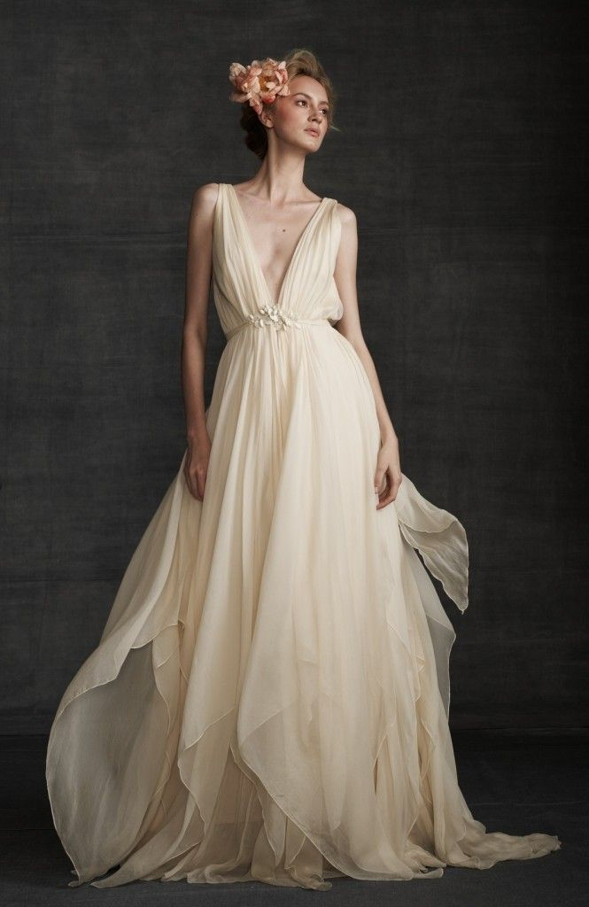 couture wedding dress. Love the skirt of it! The top is a little too revealing.