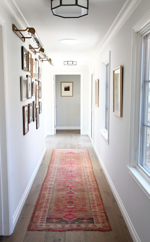 Ideas to make a dark and narrow hallway feel lighter and brighter with LRV, lights and paint colour. Photo, project by Designstiles. Article by Kylie M Interiors E-Design